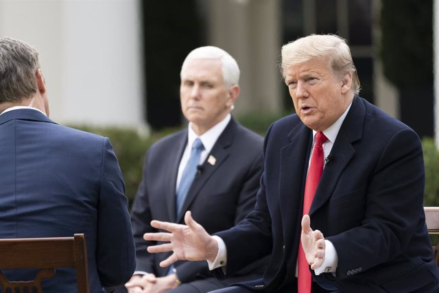 24 March 2020, US, Washington: US President Donald Trump (R) and Vice President Mike Pence (C) participate in an interview with Fox News Channel at the Rose Garden of the White House Photo: Shealah Craighead/White House via Planet Pix via ZUMA Wire/dpa