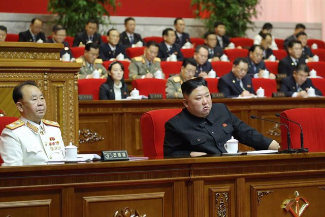 HANDOUT - 10 January 2021, North Korea, Pyongyang: A picture provided by the North Korean state news agency (KCNA) on 10 January 2021, shows North Korean Leader Kim Jong-un (R) attending the fifth day of the eighth congress of the ruling Workers' Party. P