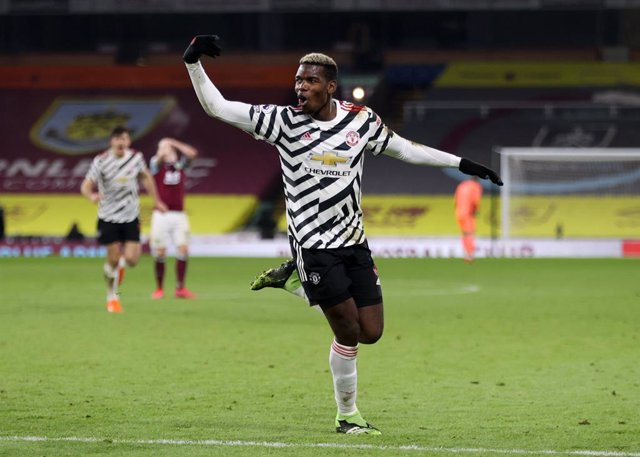 12 January 2021, England, Burnley: Manchester United's Paul Pogba celebrates scoring his side's first goal during the English Premier League soccer match between Burnley and Manchester United at Turf Moor. Photo: Clive Brunskill/PA Wire/dpa