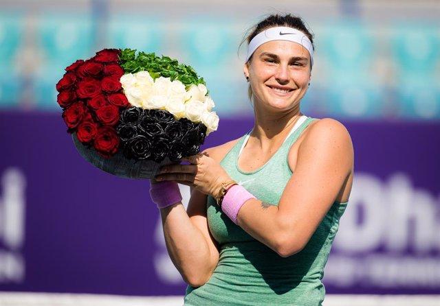 Aryna Sabalenka of Belarus poses with flowers after winning the final of the 2021 Abu Dhabi WTA Womens Tennis Open WTA 500 tournament against Veronika Kudermetova of Russia