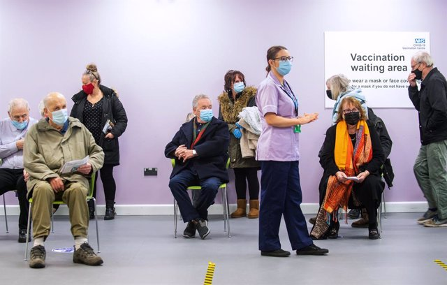 11 January 2021, England, Stevenage: People wait to receive their COVID-19 vaccine at the United Kingdom National Health Service (NHS) vaccine centre that has been set up at Robertson House. The centre is one of the seven mass vaccination centres now open