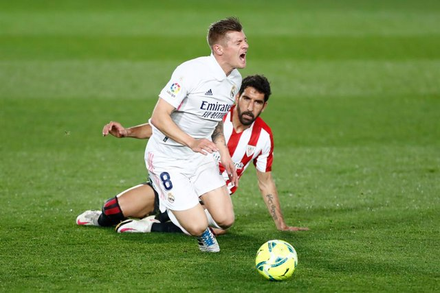 Toni Kroos of Real Madrid receives a fault from Raul Garcia of Athletic Club during the spanish league, La Liga, football match played between Real Madrid and Athletic Club de Bilbao at Alfredo di Stefano stadium on december 15, 2020, in Valdebebas, Madri