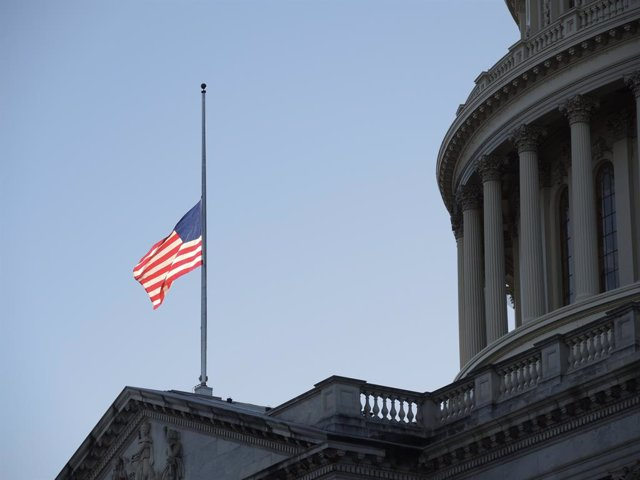 09 January 2021, US, Washington: A US flag flies at half-mast at the US Capitol in memory of police officer Brian Sicknick. Sidnick died as a result of injuries sustained during a riot by pro-Trump supporters who stormed and vandalized the Capitol on Wedn