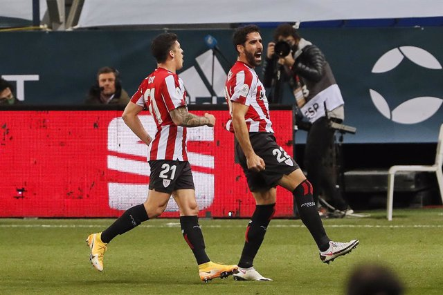 15 January 2021, Spain, Malaga: Athletic Club's Raul Garcia (R) celebrates scoring a goal during the Spanish Super Cup semifinal soccer match between Real Madrid and Athletic Club de Bilbao at La Rosaleda Stadium. Photo: -/Indira/DAX via ZUMA Wire/dpa