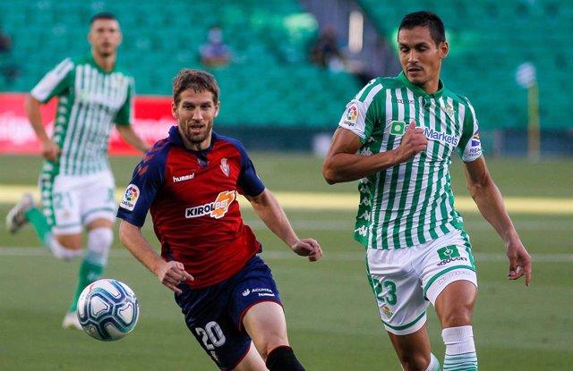 Darko Brasanac of Osasuna Aissa Mandi of Real Betis in action