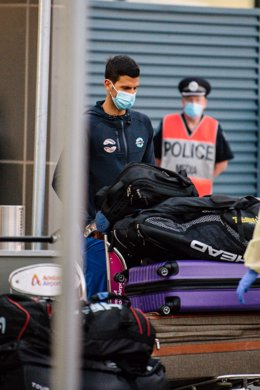 Novak Djokovic arrives at Adelaide Airport ahead of the Australian Open tennis tournament, Adelaide, Thursday, January 14, 2021. Arriving players will serve a 14-day quarantine period ahead of the scheduled major set to get underway on February 8. (AAP Im