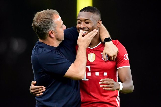 FILED - 04 July 2020, Berlin: Bayern Munich coach Hansi Flick celebrates victory with Munich's player David Alaba at the end of the German DFB Cup Final soccer match between Bayer Leverkusen and Bayern Munich in the Olympic Stadium. Bayern Munich coach Ha