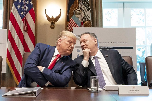 HANDOUT - 21 October 2019, US, Washington, D.C.: US President Donald Trump (L) listens to US Secretary of State Mike Pompeo during a cabinet meeting at the White House. Photo: Tia Dufour/White House/dpa - ATTENTION: editorial use only and only if the cred