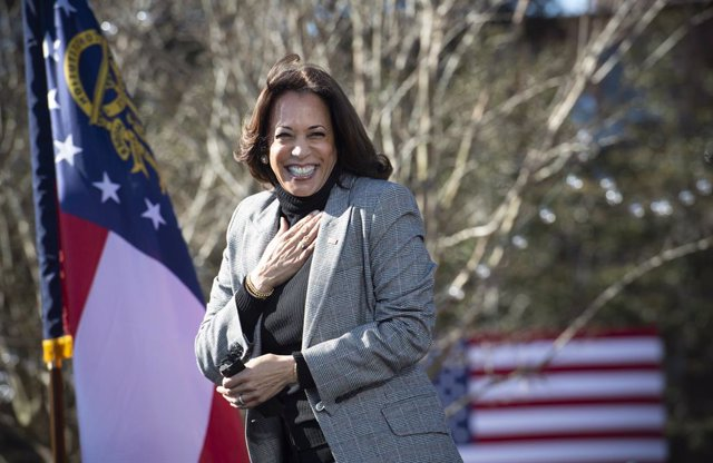 21 December 2020, US, Columbus: Vice President-Elect Kamala Harris greets supporters during a drive-in rally for Democratic senate candidates Jon Ossoff and Rev. Raphael Warnock. Ossoff and Warnock are challenging incumbent Republican senators David Perdu