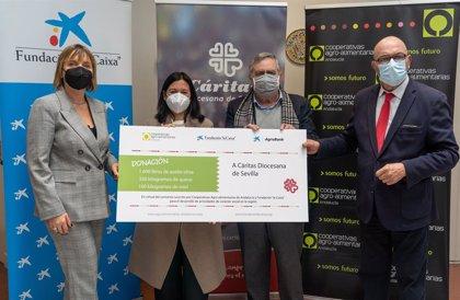 Donación de alimentos a Cáritas Sevilla de Cooperativas Agro-alimentarias de Andalucía, Fundación La Caixa y CaixaBank