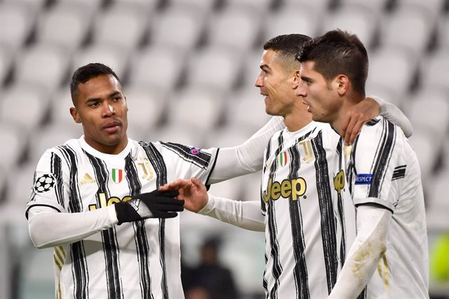 02 December 2020, Italy, Turin: Juventus' Alvaro Morata (R) celebrates scoring his side's third goal with his team mates Alex Sandro (L) and Cristiano Ronaldo during the UEFA Champions League Group G soccer match between Juventus FC and FC Dynamo Kyiv at