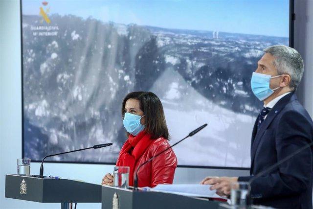 La ministra de Defensa, Margarita Robles y el ministro del Interior, Fernando Grande-Marlaska, en una rueda de prensa por el temporal Filomena