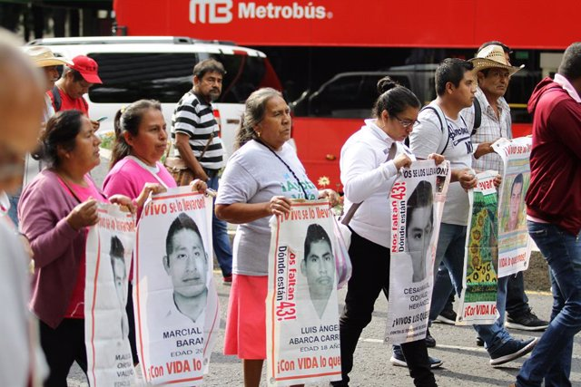 26 August 2019, Mexico, Mexico City: Relatives of the victims of the 2014 Iguala mass kidnapping protest with pictures of their disappeared family members. On 26 September 2014, 43 male students from the Ayotzinapa Rural Teachers' College were forcibly ta