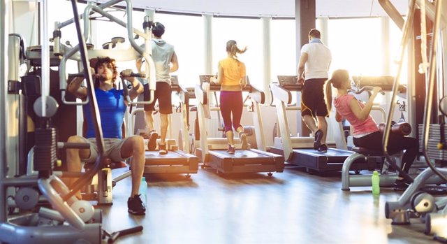 Group Of People Exercise in a gym.