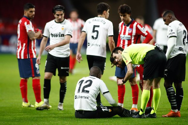 Mouctar Diakhaby of Valencia gets injured during the spanish league, La Liga, football match played between Atletico de Madrid and Valencia CF at Wanda Metropolitano stadium on january 24, 2021, in Madrid, Spain.