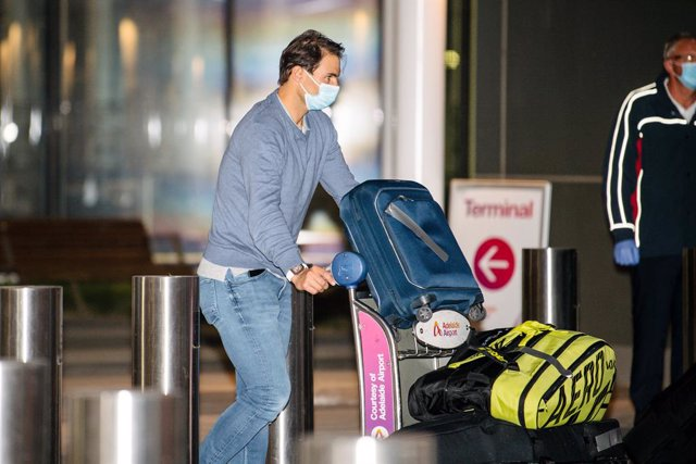 Rafael Nadal arrives at Adelaide Airport ahead of the Australian Open tennis tournament, Adelaide, Thursday, January 14, 2021. Arriving players will serve a 14-day quarantine period ahead of the scheduled major set to get underway on February 8. (AAP Imag