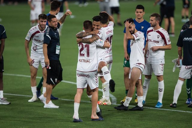 Albacete players celebrate their stay in the SmartBank League during the spanish league, LaLiga, football match played between Cadiz Club Futbol and Albacete Balompie at Ramon de Carranza Stadium on July 20, 2020 in Cadiz, Spain.