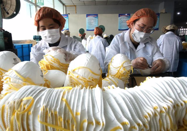 12 February 2020, China, Hebei: workers pack surgical masks at a production line manufacturing masks at a factory, amid the ongoing coronavirus crisis. Photo: Hu Gaolei/SIPA Asia via ZUMA Wire/dpa
