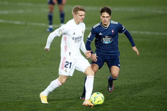 Martin Odegaard of Real Madrid and Denis Suarez of Celta in action during the spanish league, La Liga Santander, football match played between Real Madrid and Celta de Vigo at Ciudad Deportiva Real Madrid on january 02, 2021, in Valdebebas, Madrid, Spain