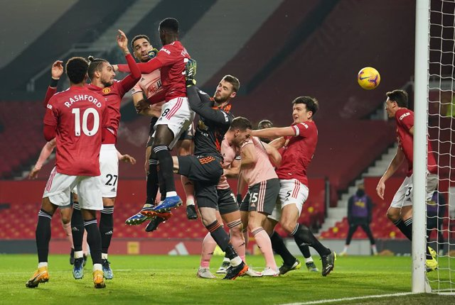 27 January 2021, United Kingdom, Manchester: Sheffield United's Kean Bryan scores his side's first goal during the English Premier League soccer match between Manchester United and Sheffield United at Old Trafford. Photo: Dave Thompson/PA Wire/dpa