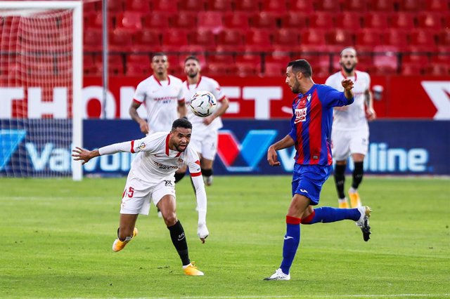 Youssef En-Nesyri of Sevilla and Recio of Eibar during LaLiga, football match played between Sevilla Futbol Club and Sociedad Deportiva Eibar at Ramon Sanchez Pizjuan Stadium on October 24, 2020 in Sevilla, Spain.