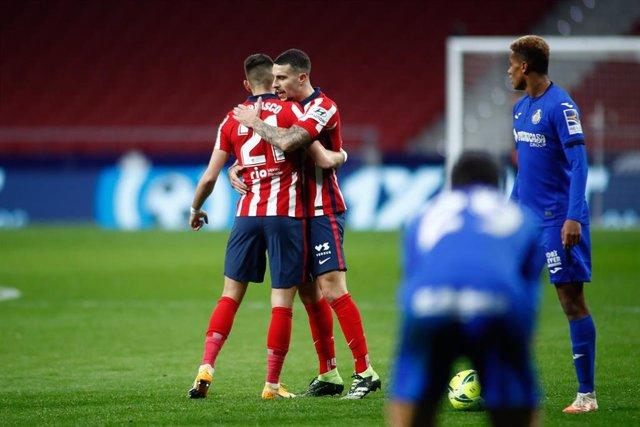 Yannick Carrasco y Mario Hermoso con el Atlético de Madrid