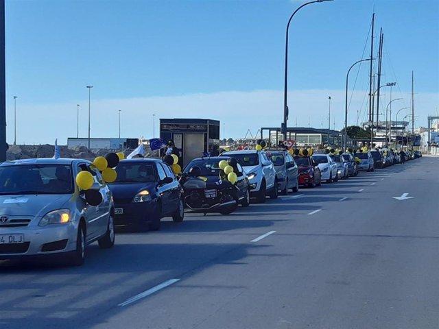 Caravana de vehiculos de empleados temporales de las Administraciones Públicas en Palma. A fecha de domingo, 31 de enero de 2020.