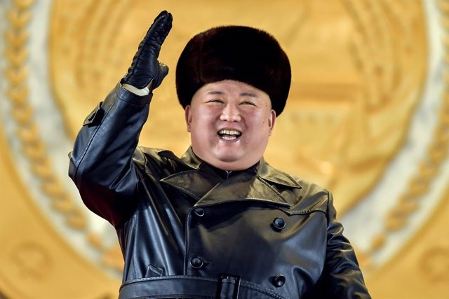 HANDOUT - 14 January 2021, North Korea, Pyongyang: A picture provided by the North Korean state news agency (KCNA) on 15 January 2021, shows North Korean leader Kim Jong-un acknowledging the crowd during a military parade at Kim Il-sung Square, to celebra
