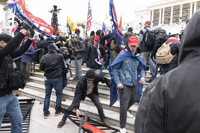 06 January 2021, US, Washington: Supporters of US President Donald Trump storm the US Capitol building during a Congress session to affirm President-elect Joe Biden's victory. Pro-Trump protesters stormed the US Capitol Building to interrupt Congress sess