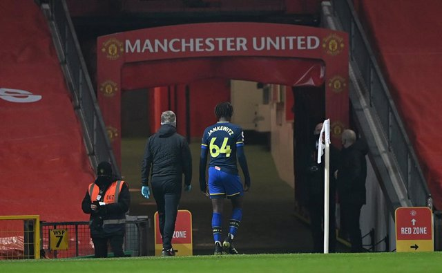 02 February 2021, United Kingdom, Manchester: Southampton's Alex Jankewitz (R) leaves the game after being shown a red card following a foul on Manchester United's Scott McTominay during the English Premier League soccer match between Manchester United an