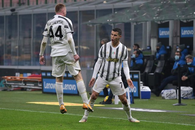 02 February 2021, Italy, Milan: Juventus' Cristiano Ronaldo celebrates scoring his side's second goal with teammate Dejan Kulusevski during the Coppa Italia semi-final first leg soccer match between Inter Milan and Juventus at the Giuseppe Meazza stadium.