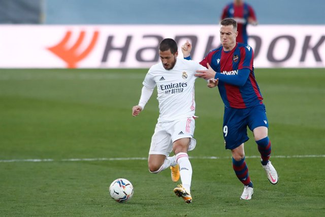 Eden Hazard of Real Madrid and Carlos Clerc of Levante in action during the spanish league, La Liga Santander, football match played between Real Madrid and Levante UD at Ciudad Deportiva Real Madrid on january 30, 2021, in Valdebebas, Madrid, Spain.