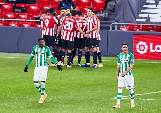 Joaquin Sanchez and Emerson Aparecido of Real Betis Balompie after receives a goal during the Spanish league, La Liga Santander, football match played between Athletic Club and Real Betis Balompie at San Mames stadium on November 23, 2020 in Bilbao, Spain