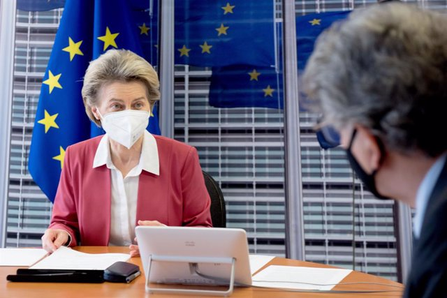 HANDOUT - 31 January 2021, Belgium, Brussels: European Commission President Ursula von der Leyen talks to EU commissioner for internal market Thierry Breton (R)during a video conference meeting with seven chief executives from pharmaceutical firms with E