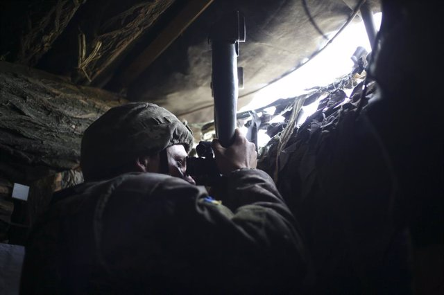 May 10, 2019 - Avdiivka, Ukraine: An Ukrainian soldier looks through a periscope in an observation bunker on the front lines. The soldiers said Donetsk People's Republic positions were about 300 meters in front of them, across a grassy field covered in la