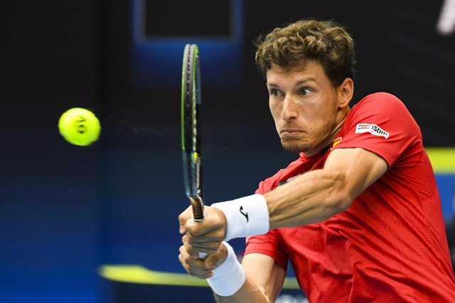 Pablo Carreno Busta of Spain in action during Round 1 of the ATP Cup against John Millman of Australia at Melbourne Park in Melbourne, Tuesday, February 2, 2021. (AAP Image/Dave Hunt) NO ARCHIVING, EDITORIAL USE ONLY