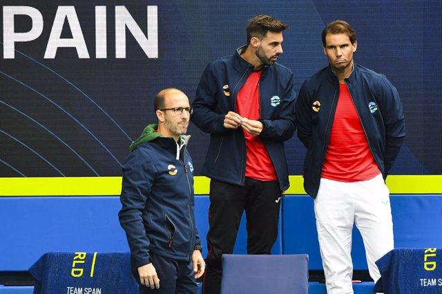 Rafael Nadal of Spain (right) reacts after pulling out of the Round 1 ATP Cup match between Australia and Spain at Melbourne Park in Melbourne, Tuesday, February 2, 2021. (AAP Image/Dave Hunt) NO ARCHIVING, EDITORIAL USE ONLY