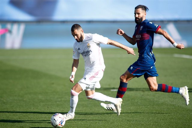 Karim Benzema of Real Madrid and Dimitrios Siovas of Huesca in action during the spanish league, La Liga Santander, football match played between Real Madrid and SD Huesca at Alfredo Di Stefano stadium on October 31, 2020, in Valdebebas, Madrid, Spain.