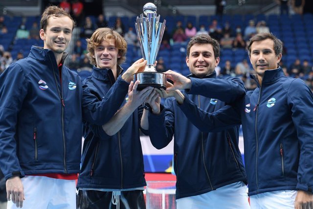 Team Russia hold the trophy after winning the ATP Cup final against Team Italy on Rod Laver Arena at Melbourne Park in Melbourne, Sunday, February 7, 2021. (AAP Image/Dean Lewins) NO ARCHIVING, EDITORIAL USE ONLY