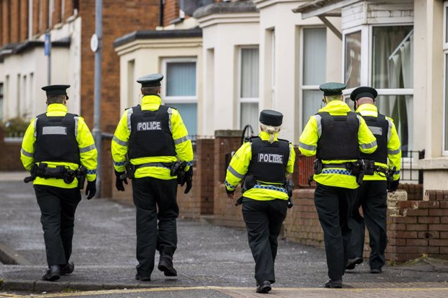 17 March 2020, Northern Ireland, Belfast: Police Service of Northern Ireland (PSNI) officers patrol the student area of Belfast known as the Holylands on St Patrick's Day. Due to Coronavirus Belfast City Council cancelled the festivities for the safety of