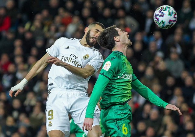 MADRID, SPAIN - FEBRUARY 6: Karim Benzema, of Real Madrid and Aritz Elustondo of Real Sociedad fight for the ball during Copa del Rey football match played between Real Madrid and Real Sociedad at Santiago Bernabeu stadium on February 6, 2020 in Madrid, S