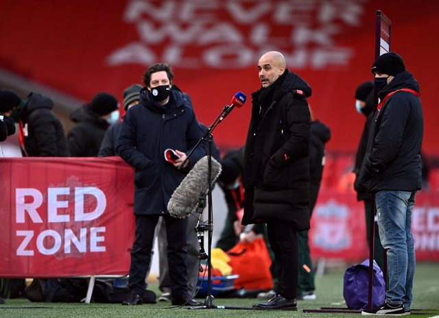 07 February 2021, United Kingdom, Liverpool: Manchester City manager Pep Guardiola gives and interview before the start of the English Premier League soccer match between Liverpool and Manchester City at Anfield. Photo: Laurence Griffiths/PA Wire/dpa