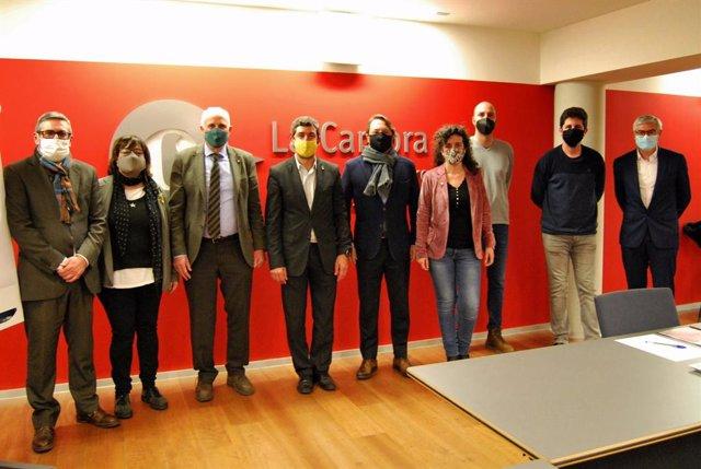 Joan Canadell en una visita a la Cambra de Terrassa amb representants del partit i de la institució