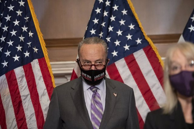 2/9/2021 - Washington, District of Columbia, United States of America: United States Senate Majority Leader Chuck Schumer (Democrat of New York), listens as United States Senator Patty Murray (Democrat of Washington) offers remarks during a press conferen