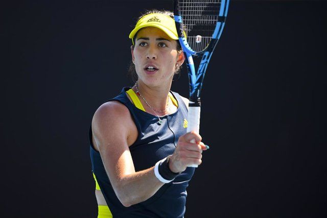 Garbine Muguruza of Spain celebrates after winning her second Round Women's singles match against Luidmila Samsonova of Russia on Day 3 of the Australian Open at Melbourne Park in Melbourne, Wednesday, February 10, 2021. (AAP Image/James Ross) NO ARCHIVIN