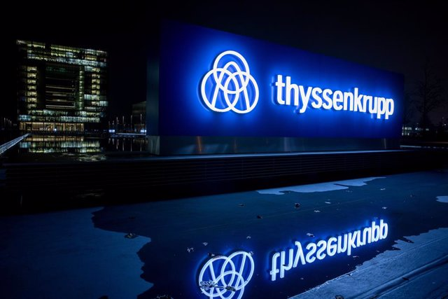 FILED - 20 November 2019, North Rhine-Westphalia, Essen: The ThyssenKrupp logo is reflected on a water surface. German steel and engineering conglomerate Thyssenkrupp has finally completed the sale of its profitable elevator division to a consortium of in