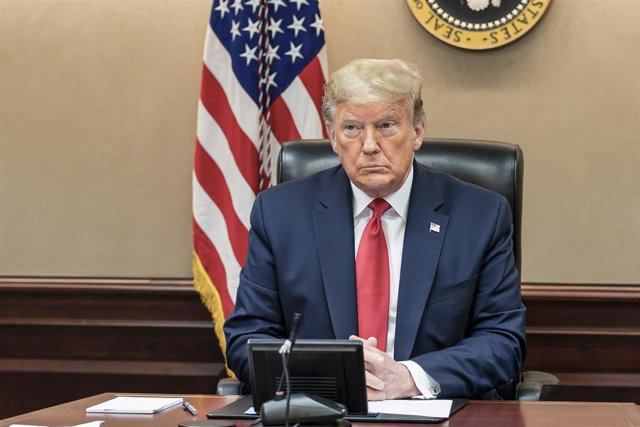 FILED - 26 March 2020, US, Washington: US President Donald Trump holds a governors' video teleconference in the White House Situation Room. USPresident Donald Trump confirmed the country's top infectious disease expert, Anthony Fauci, will testify before