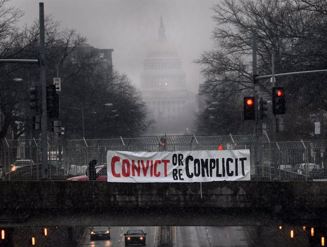 11 February 2021, US, Washington: A general view of a protest sign hangs on the overpass of the Capitol Street as the historic second impeachment trial continues against former USPresident Donald Trump. Photo: Carol Guzy/ZUMA Wire/dpa