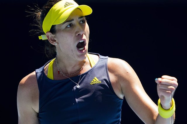 Garbine Muguruza of Spain celebrates after winning her third Round Women's singles match against Zarina Diyas of Kazakhstan on Day 5 of the Australian Open at Melbourne Park in Melbourne, Friday, February 12, 2021. (AAP Image/Dave Hunt) NO ARCHIVING, EDIT
