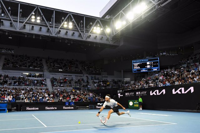 Spectators watch Dominic Thiem of Austria in action during his third Round Men's singles match against Nick Kyrgios of Australia on Day 5 of the Australian Open at Melbourne Park in Melbourne, Friday, February 12, 2021. (AAP Image/Dave Hunt) NO ARCHIVING,